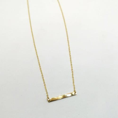 Jednostavna zlatna ogrlica od žutog zlata s pločicom