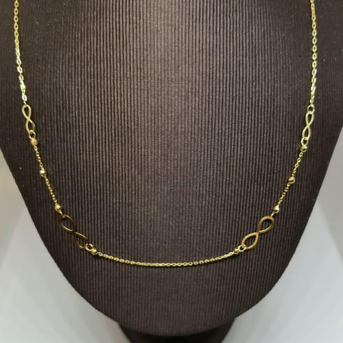 Zlatna ogrlica od žutog zlata sa simbolom beskonačnosti